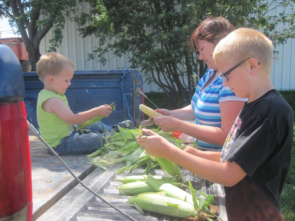 wagner family shucking sweet corn years ago