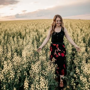 Lesley Kelly in a canola field